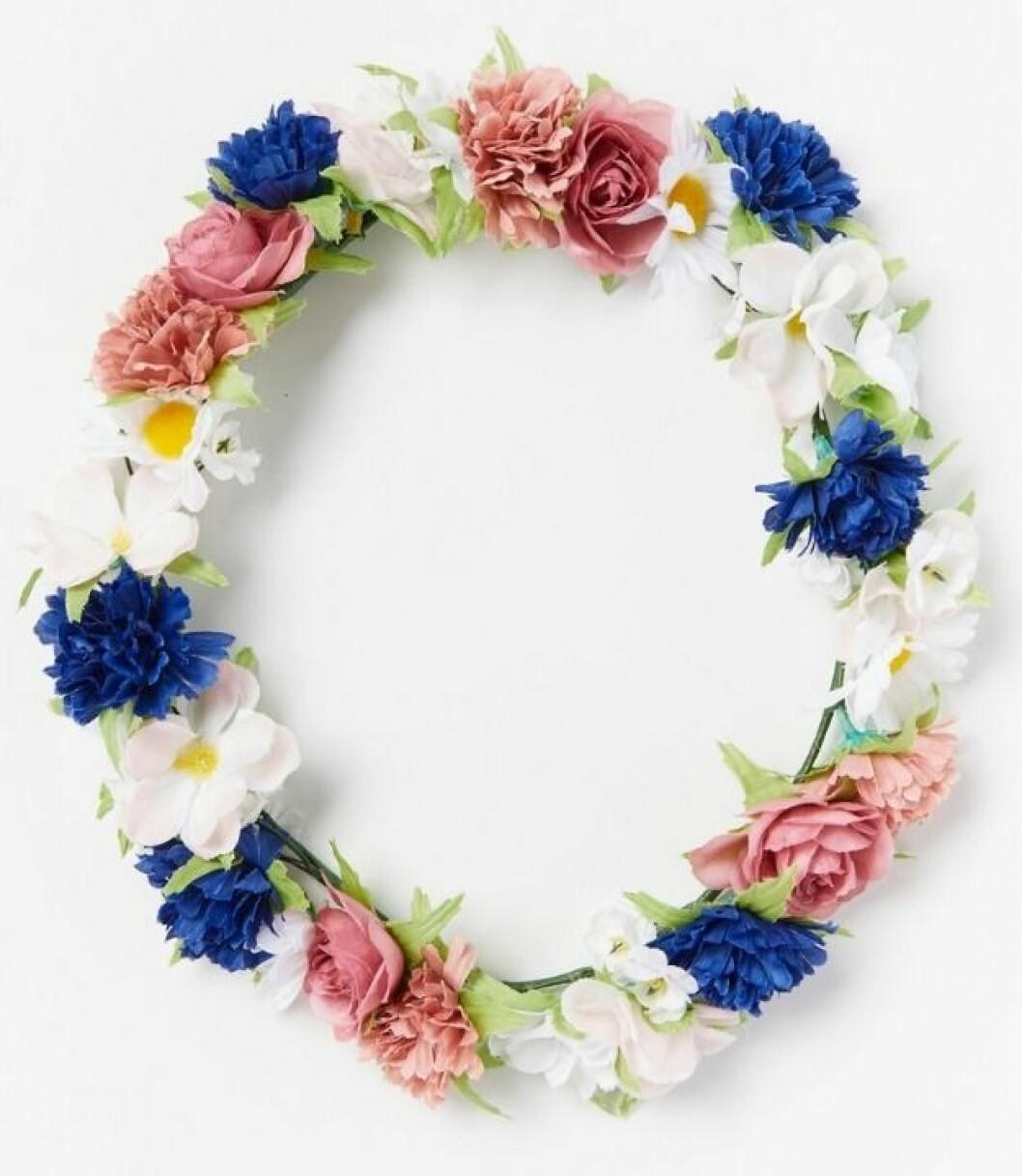 blomsterkrans med tygblommor som du kan köpa på Lindex
