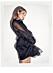 Bianca Ingrosso frontar festkollektion för Gina tricot – svart volangklänning