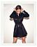 Bianca Ingrosso frontar festkollektion för Gina tricot –svart paljettklänning