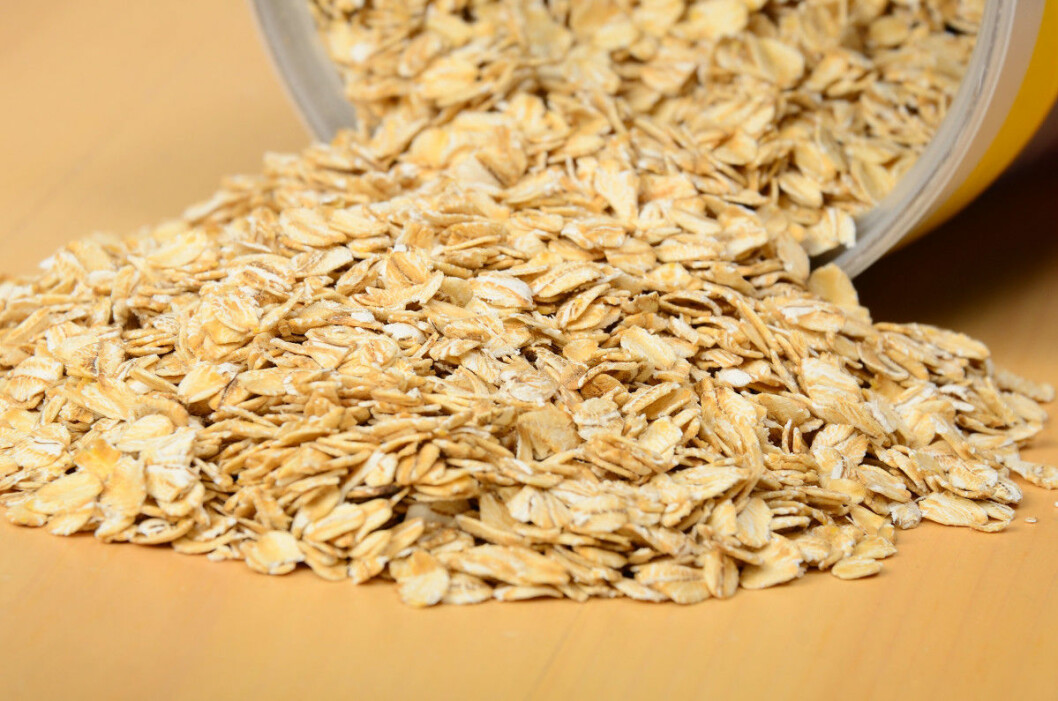 Oatmeal spilling out of bin. Selective focus on middle of pile.